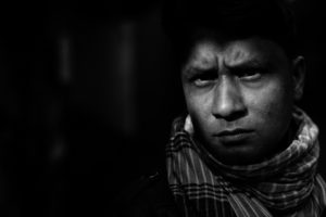 close up portrait of a man in Rashjahi market in Bangladesh