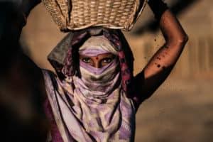 Women carrying coal in a brick factory near Sylhet in Bangladesh