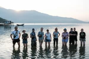 Photography students pose in Lang Co lagoon in Vietnam with Pics of Asia