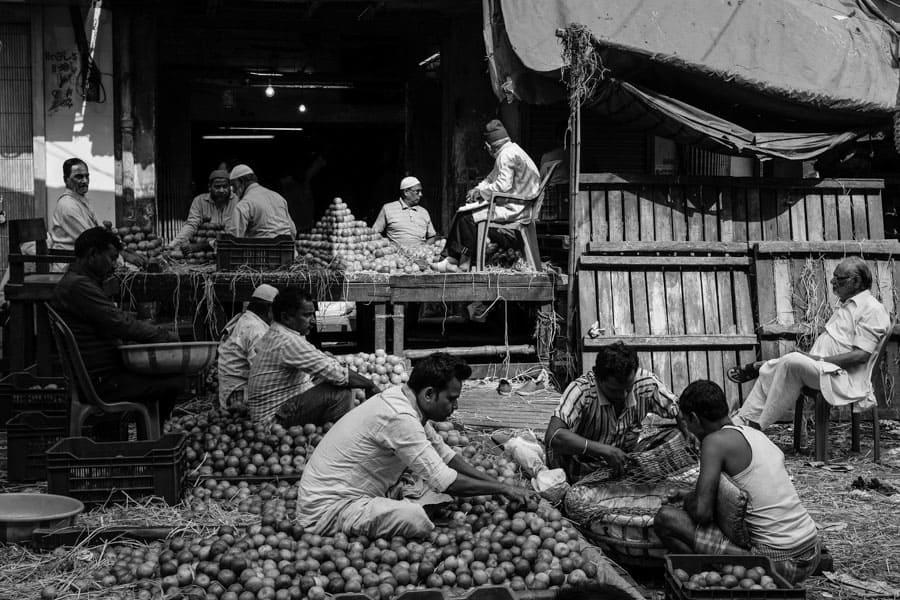 men sitting on the street in Kolkata