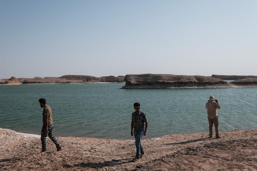 People visiting the salt lake in the Lutz desert in Iran